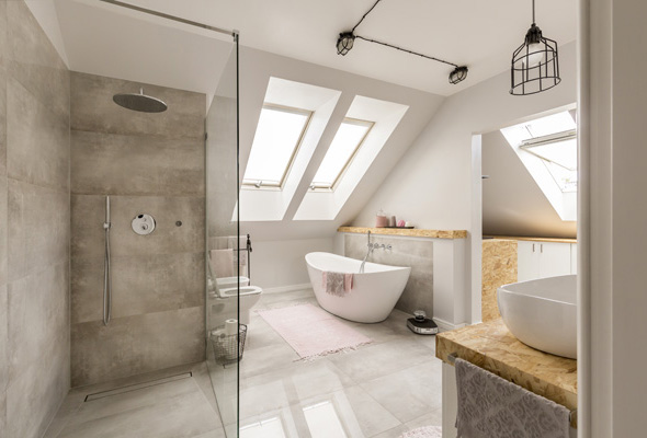 Modern bathroom interior with minimalistic shower and lighting, white toilet, sink, bathtub and roofwindows